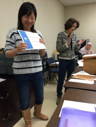 Susan receives the Evaluation certificate from President Margaret Collenberg.