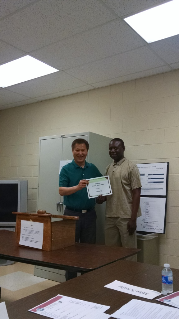Isaac receives a membership certificate from VPM Young. By Margaret Collenberg.